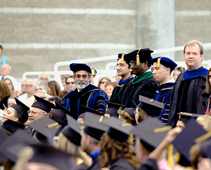 Picture of NSC employees at commencement ceremony