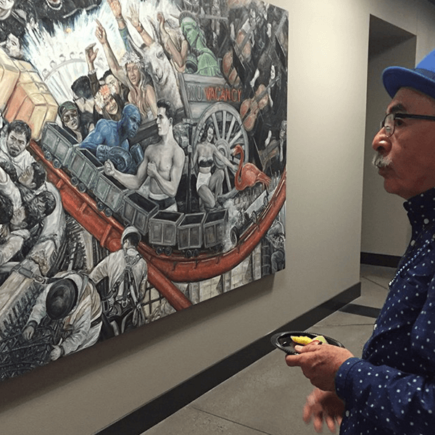 Former Poet Laureate admiring art on NSC campus