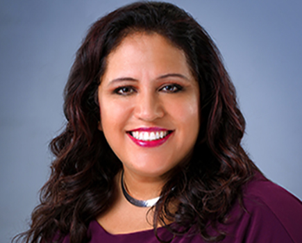 Close up of headshot of Edith Fernandez, Vice President of College and Community Engagement.