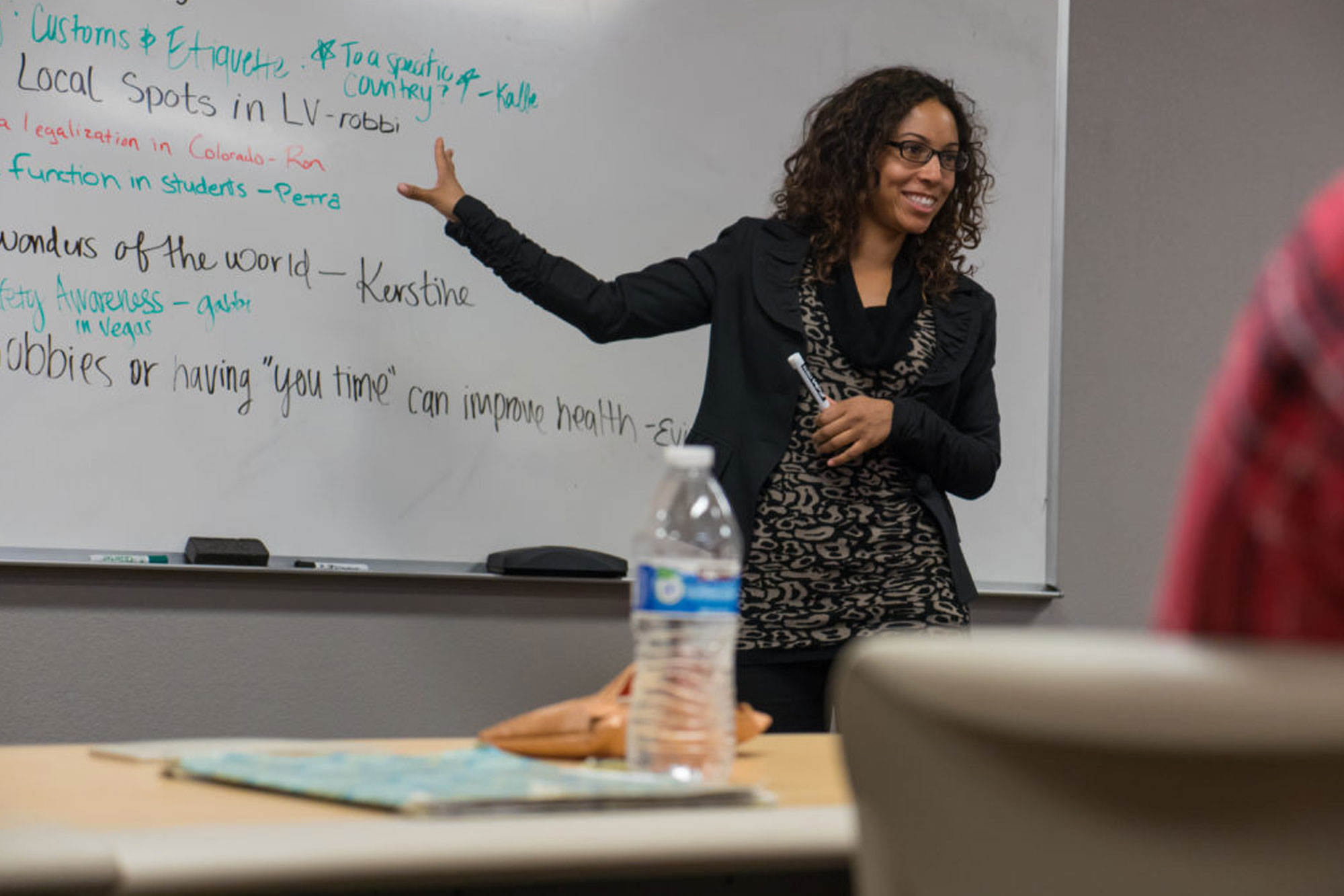 Communications Professor, Dr. Jasmine Phillips using whiteboard to teach