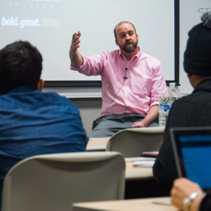 Criminal Justice Professor lecturing to students in classroom