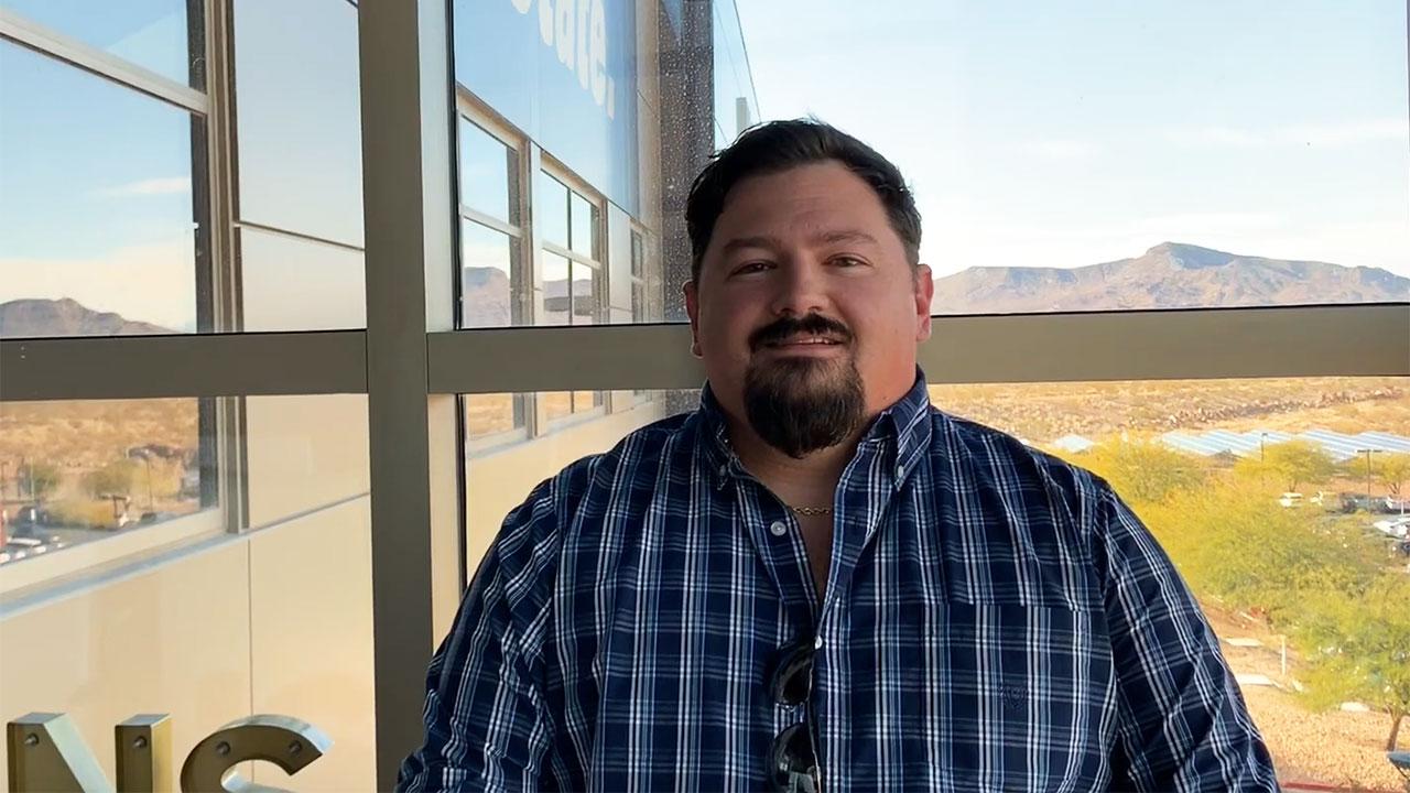 RJ headshot in front of Nevada desert