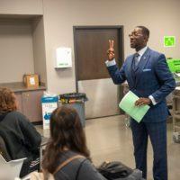 Charles addressing students